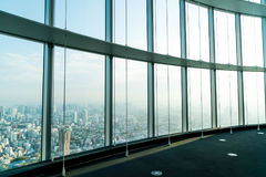 Window of building with Tokyo Tower background. Glass window of building with Tokyo Tower background Stock Photo