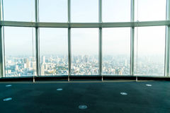 Window of building with Tokyo Tower background. Glass window of building with Tokyo Tower background Royalty Free Stock Images