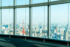 Window of building with Tokyo Tower background. Glass window of building with Tokyo Tower background Stock Photos