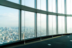 Window of building with Tokyo Tower background. Glass window of building with Tokyo Tower background Royalty Free Stock Image