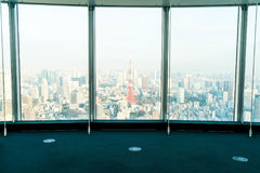 Window of building with Tokyo Tower background. Glass window of building with Tokyo Tower background Royalty Free Stock Photography