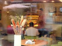 The window of the cafe, bathed in rain stock photo