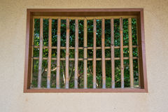 Window cage with wood bars. On vertical royalty free stock image
