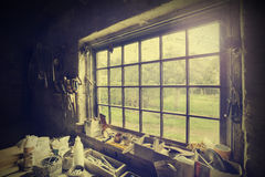 Window in carpenter's workshop, vintage style. Royalty Free Stock Photos