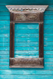 Window carved architraves of an old traditional wooden house in the Russian village Stock Photos