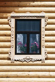 Window with carved architraves Stock Photography