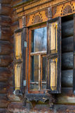 Window with carved wooden trims Royalty Free Stock Image