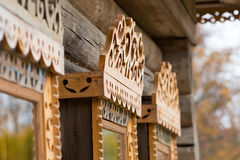 Window with carved wooden trims Stock Photo