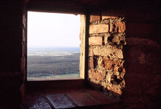 Window in a castle. View through a window in a castle in hungaria stock image