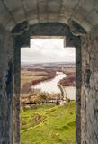 Window of castle. River after the window of a castle in Spain in a cloudy day stock image