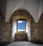Window of a castle tower. Ancient castle window, passage to the freedom Royalty Free Stock Image