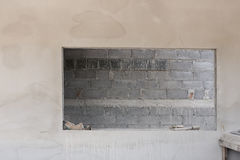 Window on cement wall with brick wall background Royalty Free Stock Image