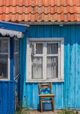 Window and chair of a house in Nida Stock Photography