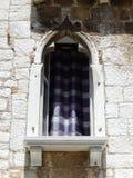 WINDOW WITH CHECKERED PURPLE WHITE CURTAIN, POREC, CROATIA Stock Photo
