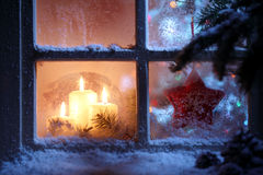 Window with Christmas decoration. Frosted window with Christmas decoration