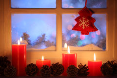 Window with Christmas decoration. Frosted window with Christmas decoration Royalty Free Stock Photo