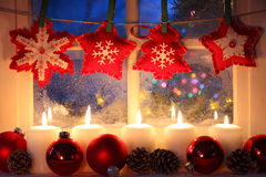Window with Christmas decoration. Frosted window with Christmas decoration Stock Images