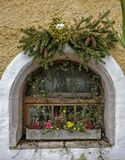 Christmas decorations. A window with Christmas decorations and flowers Stock Photo