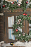 Window  with Christmas decorations. Window and shutters with Christmas decorations Stock Photo
