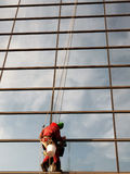 Window cleaner cleans the windows with a rag to brilliance. Stock Photography