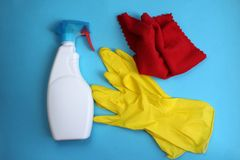Window cleaner gloves and rag for cleanliness. Cleaning, house, background, service, gloves, window, rubber, concept, detergent, home, clean, accessories, rag stock photography