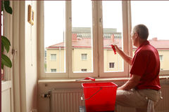 Window cleaner a gray day Royalty Free Stock Photography