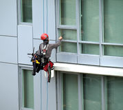 Window cleaner in a high rise Royalty Free Stock Images