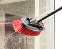 Window cleaner  - reach and wash system. Window cleaning using a reach and wash system. The cleaning brush is used to clean glass windows by using pure water so Stock Photos