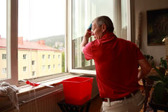 Window cleaner sees something on the street Royalty Free Stock Images