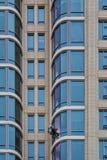 Window Cleaner on Sky Scraper. Man washing windows on a sky scraper Royalty Free Stock Image