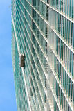 Window cleaner skyscraper. View of a skyscraper with window cleaners at work stock photography