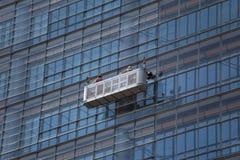 Window cleaner on skyscraper windows Royalty Free Stock Image
