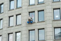Window cleaner washing elevation of building windows Stock Image