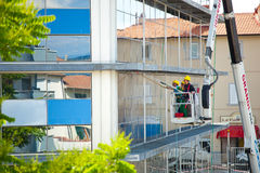 Window cleaner working on a glass facade. Royalty Free Stock Photos