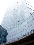 Window cleaners climbing glass building Royalty Free Stock Image