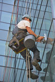 Window cleaners on office building, photo taken 20.05.2014. Professional, window cleaners alpinist climber, washing windows on business building, photo taken 20 Royalty Free Stock Image