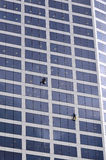 Window cleaners works on high rise building Royalty Free Stock Photos