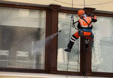 Window cleaning by industrial climber royalty free stock images