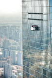 Skyscraper with window cleaner in Shanghai Royalty Free Stock Images