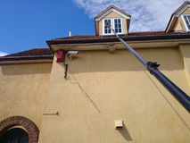 Window cleaning. Cleaning windows using the pole system royalty free stock images