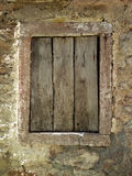 Window. Closed old wooden window shutters on the stone wall Stock Images