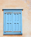 Window with closed shutters Stock Images