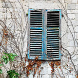 Window with closed shutters Royalty Free Stock Photos