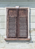 Window with closed shutters Stock Photography