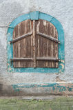 Window with closed shutters in the street Royalty Free Stock Photography