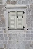 Window closed white shutters, Montenegro. close-up Royalty Free Stock Image