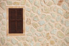Window with closed wooden shutters Royalty Free Stock Image