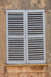 Window with closed wooden shutters Royalty Free Stock Photography