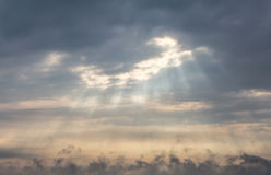 Window in clouds roof. Sun beams from a hole in clouds and yellow sky Stock Photography