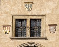 Window and coats of arms, Old Town Hall, Prague Czech republic. Pictured is a window and coats of arms on the outside of the Old Town Hall, Prague, Czech stock images